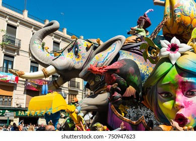 VALENCIA, SPAIN - MARCH 19, 2017: Detail of colourful ninots (cardboard and paper-mache puppet statue) and fallas on the streets of Valencia during the Fallas festival, on March 19, 2017.
