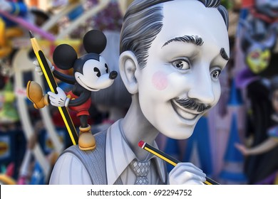 VALENCIA, SPAIN - MARCH 19, 2017:Photo with blurred background of Walt Disney ninot sculpture exhibited in the street on the occasion of the festivals of fallas with sunny day