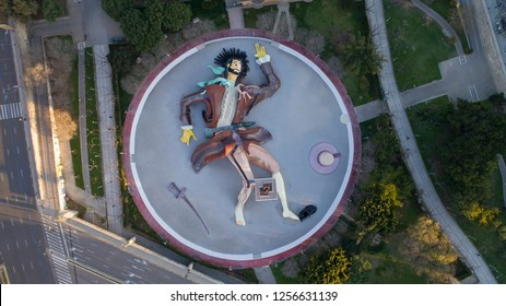 VALENCIA, SPAIN, MARCH 2018: Aerial, Drone view from above of Gulliver playground in Turia's gardens, Park with giant stylized Gulliver sculpture