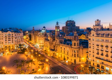 Valencia, Spain - March 27, 2018: High angle view on the City Hall and Town Square in Valencia Spain at dusk.