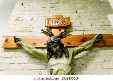 Valencia, Spain - March 30, 2019: Detail of a carved crucifix with the face of Jesus on the altar of a church with the inscription INRI.