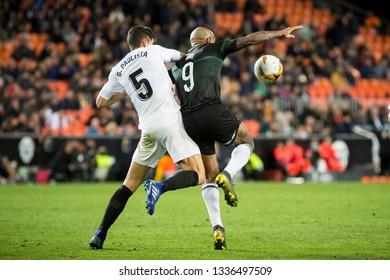 VALENCIA, SPAIN - MARCH 7: (5) Paulista, (9) Ari during UEFA Europa League match between Valencia CF and FC Krasnodar at Mestalla Stadium on March 7, 2019 in Valencia, Spain