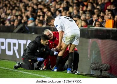 VALENCIA, SPAIN - MARCH 7: (5) Paulista injured during UEFA Europa League match between Valencia CF and FC Krasnodar at Mestalla Stadium on March 7, 2019 in Valencia, Spain