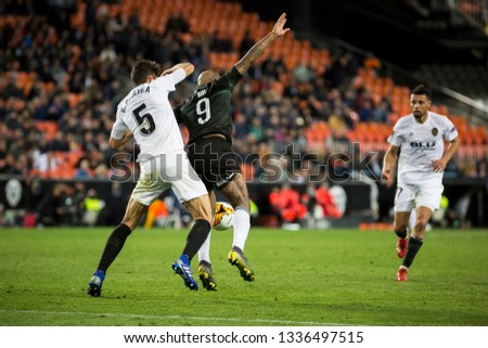 VALENCIA, SPAIN - MARCH 7: (5) Paulista, (9) Ari during UEFA Europa League match between Valencia CF and FC Krasnodar at Mestalla Stadium on March 7, 2019 in Valencia, Spain