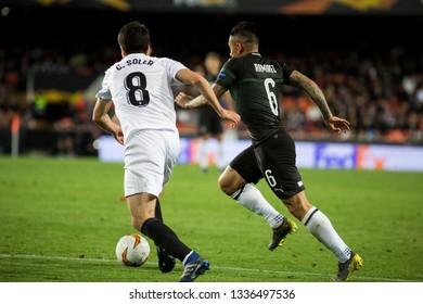 VALENCIA, SPAIN - MARCH 7:(8) Soler, (6) Ramirez during UEFA Europa League match between Valencia CF and FC Krasnodar at Mestalla Stadium on March 7, 2019 in Valencia, Spain