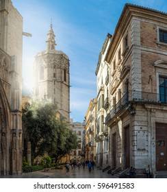 VALENCIA, SPAIN - MARCH 8, 2017: Street view near Virgin square and Saint Mary's in the city of Valencia Spain. Sunny, bright street early in the morning. Tourists walking.