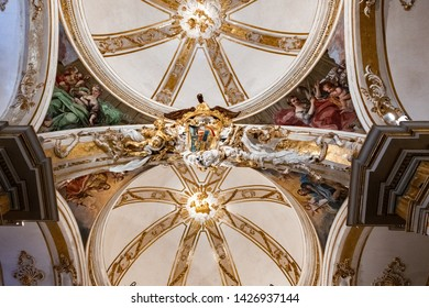 Valencia, Spain - May 03, 2019: 17th Century Frescoes and Altar in the Church of Saint Nicholas and Saint Peter Martyr in Valencia, Spain