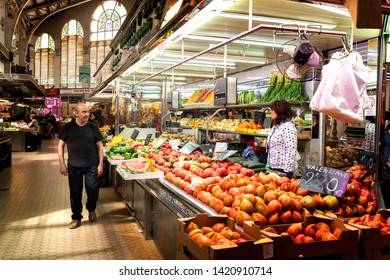 VALENCIA, SPAIN, MAY 04, 2019 : Customers are doing their groceries inside of the central market in valencia