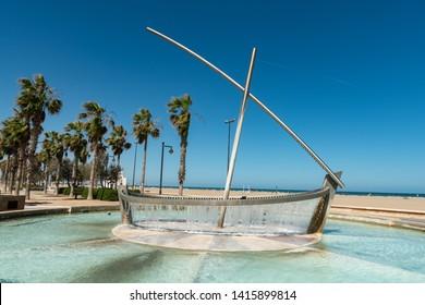 Valencia / Spain - May 05 2019 : Boat statue in a fountain at the Malvarrosa beach