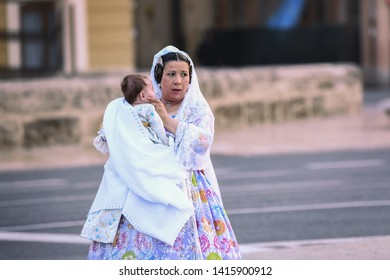 VALENCIA, SPAIN - MAY 07, 2019: Traditional dresses ansd clothes of a spanish woman in Valencia