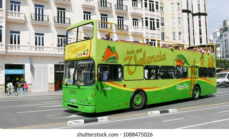 VALENCIA, SPAIN - MAY 10, 2018: A green Valencia City Tour Bus with tourist in the streets of Valencia. In 2017 Spain had 82 million tourist.