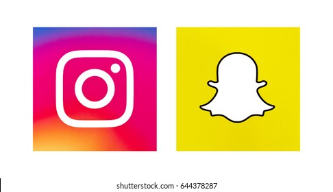 Valencia, Spain - May 16, 2017: Collection of popular social media logos printed on paper:  Instagram and Snapchat.