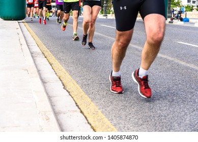 Valencia, Spain - May 19, 2019: Legs of unrecognizable runners running towards the finish line of an amateur race.