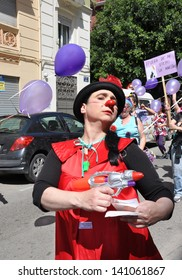 VALENCIA, SPAIN - MAY 25: One of the Female Clowns of 2nd Female Clown Solidarity (II Trobada Solidaria De Dones Pallasses) marching for women's rights through the streets of Valencia, May 25, 2013.