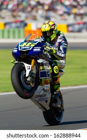 VALENCIA, SPAIN - NOV 10: Valentino Rossi pulls a wheelie during MotoGP Grand Prix of the Comunitat Valenciana on November 10, 2013, Valencia, Spain