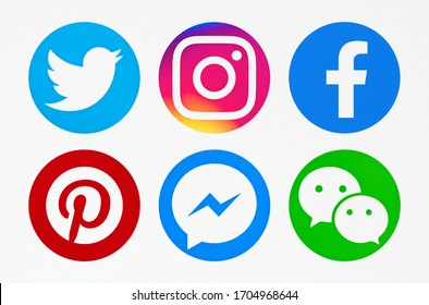 Valencia, Spain - November 06, 2018: Collection of popular social media logos printed on paper: Twitter; Facebook; Instagram, Pinterest, Messenger, WeChat.