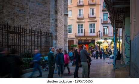 Valencia / Spain - November 1, 2018: A photo of the Carrer Del Micalet street where is located the popular Micalet tower, also known as Miguelete tower, next to the beautiful Valencian Cathedral.