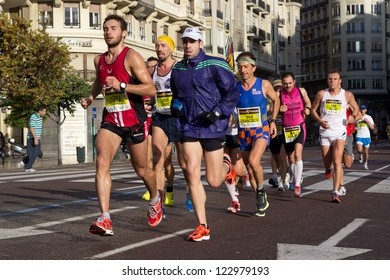 VALENCIA, SPAIN - NOVEMBER 18: Runners compete in the XXXII Valencia Marathon on November 18, 2012 in Valencia, Spain.