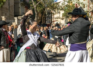 VALENCIA, SPAIN - NOVEMBER 6, 2016. Man and women in local costumes,perform a traditional dance on Plaza del Mercado (Placa del Mercat),Valencia,at 100 years since the founding of the central market.