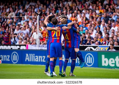 VALENCIA, SPAIN - OCT 22: Barcelona players celebrate a goal at the La Liga match between Valencia CF and FC Barcelona at Mestalla on October 22, 2016 in Valencia, Spain.