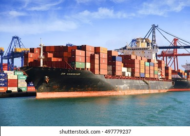 VALENCIA, SPAIN - october 02. The big container ship ZIM VANCOUVER waits docked for download his  containers in Valencia harbor, on October 02, 2016 in Valencia.