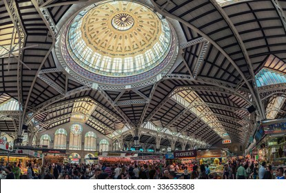 VALENCIA, SPAIN - OCTOBER 10, 2015: View of crowded Central Market interiors. It is considered one of the oldest European markets still running, most vendors sell food items. Beautiful design
