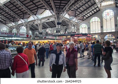 VALENCIA, SPAIN - OCTOBER 15, 2013: View of crowded Central Market. It is considered one of the oldest European markets still running, most vendors sell food items.