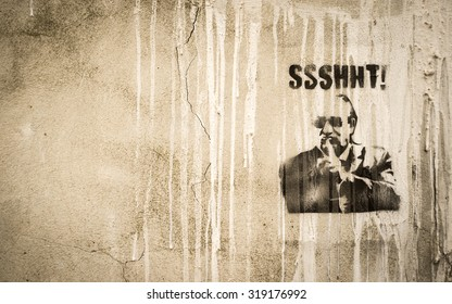 Valencia, Spain - October 26: A satirical stencil work of graffiti on the wall of a building in Valencia, Spain, feature a well dressed mafia character suggesting secrecy.