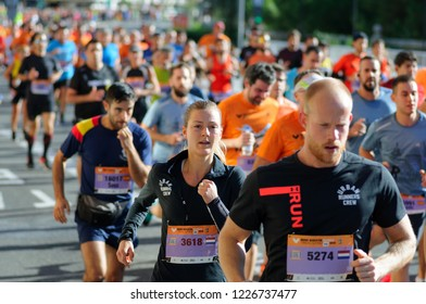 VALENCIA, SPAIN - OCTOBER 28, 2018: Runners participate in Valencia-Trinidad Alfonso EDP Half-Marathon 2018. Group of sporty people running city marathon
