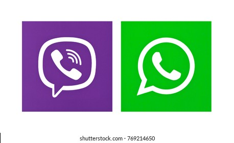 Valencia, Spain - October 31 , 2017: WhatsApp and Viber logos printed on paper. WhatsApp and Viber is an instant messaging applications for smartphones.