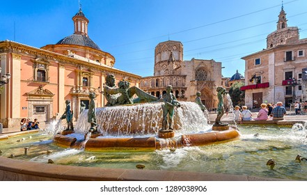 Valencia, Spain - October 6, 2018: The Square of the Virgin Mary (Plaza de la Virgen) with the Cathedral of St. Mary, the Basilica of the Virgin Mary and the fountain.