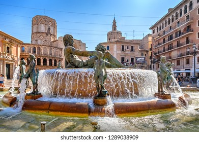 Valencia, Spain - October 6, 2018: Plaza of the Virgin Mary (Plaza de la Virgen) with the Cathedral of St. Mary and the fountain.
