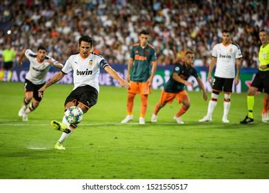 VALENCIA, SPAIN - OCTUBER 2: Parejo kicks a penalty during UEFA Champions League match between Valencia CF and AFC Ajax at Mestalla Stadium on Octuber 2, 2019 in Valencia, Spain