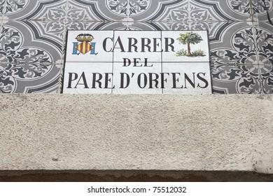 Valencia, Spain. Old stylish ceramic street sign.