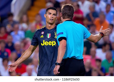 VALENCIA, SPAIN - SEP 19: Cristiano Ronaldo discusses with the referee at the UCL match between Valencia CF and Juventus FC at Mestalla on September 19, 2018 in Valencia, Spain.