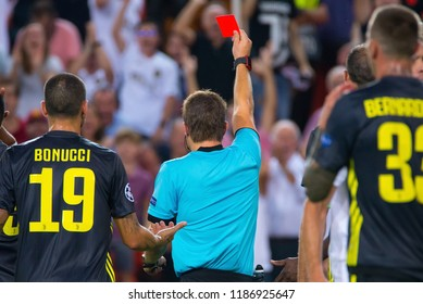 VALENCIA, SPAIN - SEP 19: The referee Felix Brych shows a red card at the UCL match between Valencia CF and Juventus FC at Mestalla on September 19, 2018 in Valencia, Spain.