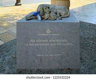 "VALENCIA, SPAIN - SEPTEMBER 01, 2018: Sculpture ""Callejeros"" by artist Elena Negueroles, donated to city of Valencia in 2018 with the intention of condemning of cruelty of abandonment of pets."