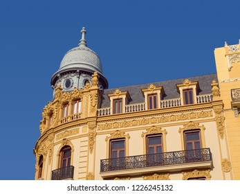 VALENCIA, SPAIN - SEPTEMBER 01, 2018: Upper part of a luxury historic house located at eastern side of Placa de l'Ajuntament (Town Hall Square) of Valencia city.