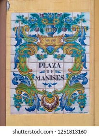 VALENCIA, SPAIN - SEPTEMBER 01, 2018: Nameplate of Plaza de Manises square, made of painted and glazed ceramic tiles in typical Spanish manner.