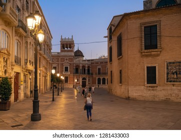 VALENCIA, SPAIN - SEPTEMBER 01, 2018: Evening view of Plaza de Decim Juni Brut square in historic city center, with some tourists walking around.