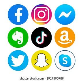 Valencia, Spain - September 13, 2020: Collection of popular social media logos printed on paper: Facebook, Instagram, Twitter, TikTok, Skype, Evernote, Amazon, Messenger, Snapchat.