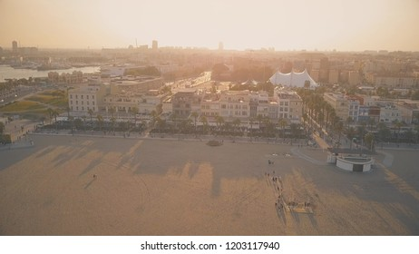 VALENCIA, SPAIN - SEPTEMBER 22, 2018. Aerial view of the beachfront hotels and restaurants in the evening