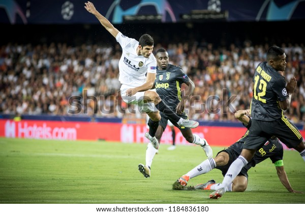 VALENCIA, SPAIN - SETEMBER 19: Guedes shots during UEFA Champions League match between Valencia CF and Juventus at Mestalla Stadium on September 19, 2018 in Valencia, Spain