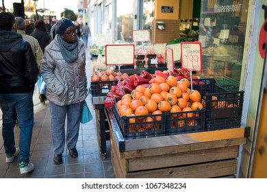 valencia Spain.01/17/2018 Woman buying fruit after the product's rise. fruit stores change prices