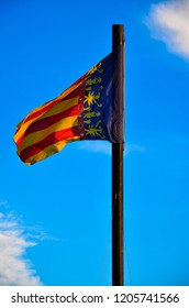 Valencian Community Flag. Valencian Flag. Flag of Valencia. Reial Senyera. Valencian Flag on a Flagpole. Red, yellow and blue.