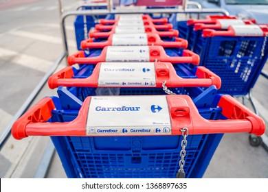 Valencia,Spain - April 13, 2019: Carrefour shopping cart. Pushcart at a supermarkets parking lot.