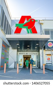 Valencia,Spain - April 27, 2019: Entrance to the  Auchan supermarket. Big auchan logo on the top. French international retail group