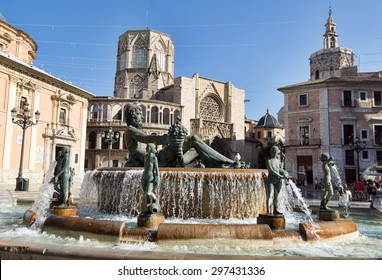 VALENCIA,SPAIN - Jine 25, 2015: Square of Saint Mary's and fountain Rio Turia.  Every year, Valencia welcomes more than 4 million visitors.