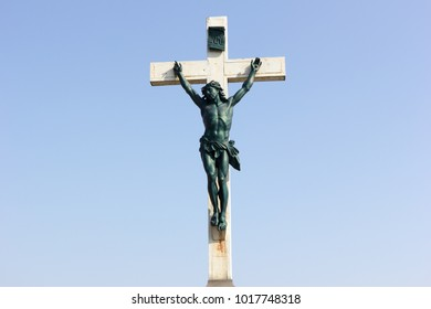 Valenciennes, France. 16 March 2017. The cross with Jesus Christ in the middle of Saint-Roch cemetery in Valenciennes.