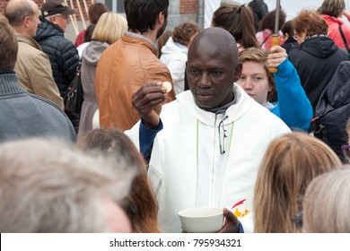 Valenciennes, France. September 10 2017. A celebration of the feast of Notre-Dame du Saint-Cordon (Holy Mary of the holy cordon or thread). A priest distributing the holy communion.